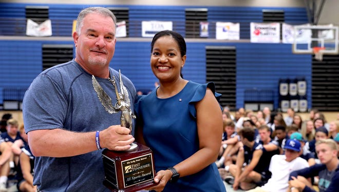Siegel athletic director Greg Wyant receives The Daily News Journal/First Tennessee Bank All Sports Trophy from Yolanda Greene, First Tennessee market president Rutherford County, on Thursday.
