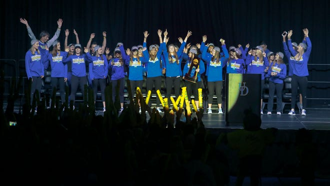 University of Delaware field hockey team members greet the crowd during an event celebrating the team's first NCAA title at the Bob Carpenter Center Friday.