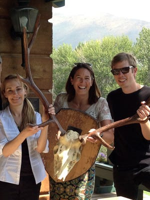 Anita Thompson, left, is joined by Library Executive Director Jenny Emery Davidson, middle, and Program Manager Scott Burton as they pose with trophy antlers while returning them to the former home of writer Ernest Hemingway Aug. 5, 2016, in Ketchum, Idaho. Gonzo journalist Hunter S. Thompson so admired the set of trophy elk antlers when he visited the central Idaho home of Hemingway, that he stole them.
