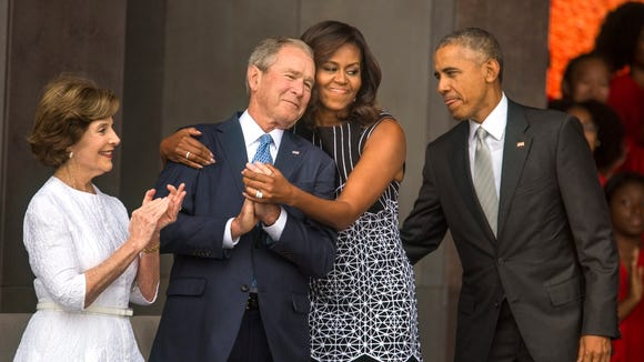 First lady Michelle Obama hugs former President George