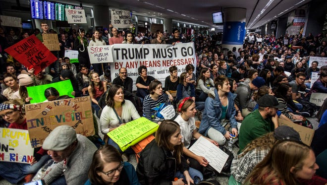 People gather for a protest at the Arrivals Hall of San Francisco International Airport on Saturday.