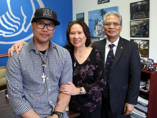 """Tony Chhim with his parents Neang and Tim Chhim at his father's insurance office in Nanuet. Chhim, 31, will be undergoing a second kidney transplant surgery next month thanks to donor Taylor Tagg, a friend of his father. In 2010, Neang donated her kidney to Tony. """"My mom gave me life twice,"""" Tony said."""