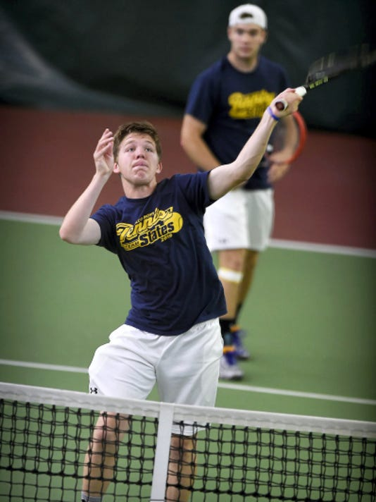 Elco tennis players Adam Bahney and Galen McNaughton fought aggressively in the championships at Hershey Racquet Club against Holy Ghost's Mark Pabalan and Brandon Fritze to capture the 2015 PIAA Boys Doubles Tennis PIAA Championships Saturday, May 23. Bahney watches McNaughton lob one over the net.