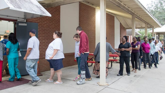 Voters make their way into the polling location at the Fricker Center on Election Day in Pensacola on Tuesday, November 8, 2016.