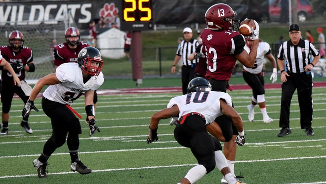 Harding's Nick Middlesworth gets ready to tackle a Newark receiver. Middlesworth caught a touchdown and helped Harding to its first win of the season at Fairbanks on Friday.