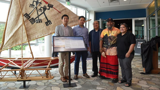"A ceremony for the handover of the Chamoru Sakman outrigger replica canoe ""Tasi"" from Lotte Duty Free to the Guam Museum was held on June 29, 2017. From left: Lotte Duty Free Chief Financial Officer David Jung, Lotte Duty Free Chairman Executive Officer Jaeha Kim, Department of Chamorro Affairs President Johnny Sablan, Traditions About Seafaring Islands member Ignacio R. ""Nash"" Camacho, and the Guam Museum's Museum Director Dominica Tolentino."