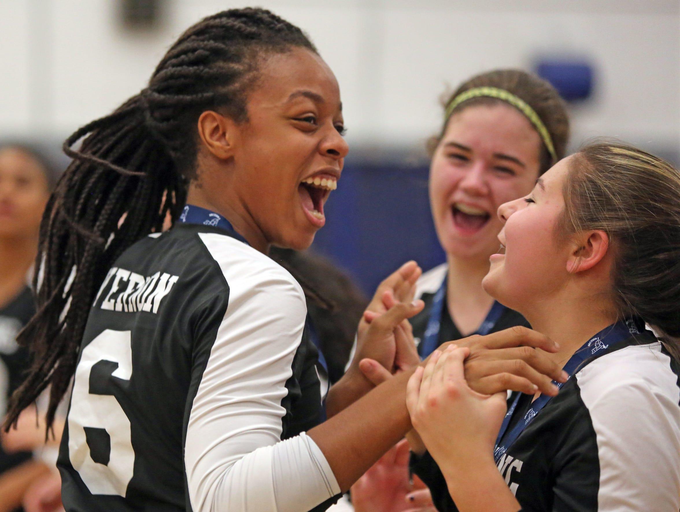 Ossining's Mychael Vernon (6) celebrates with her team