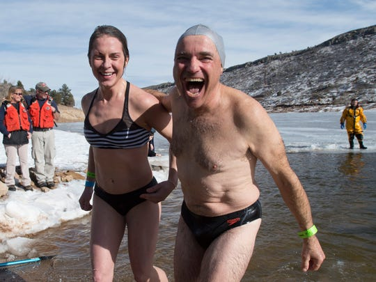 William Portilla and Sarah Reedstrom emerge from the icy water at Horsetooth Reservoir during the Polar Bear Plunge Saturday, January 23, 2016. Hundreds braved a dip in the 38-degree water in the annual event.