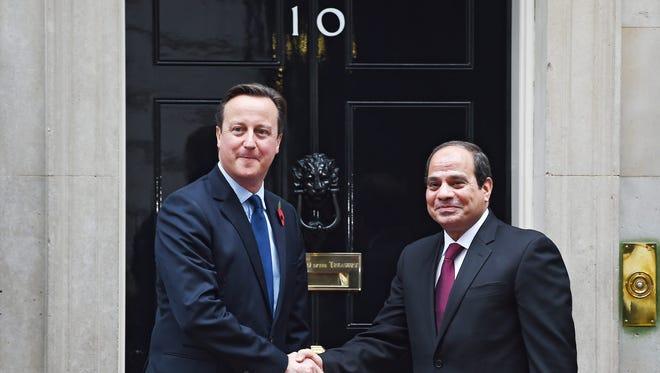 British Prime Minister David Cameron  welcomes Egyptian President Abdel Fattah al-Sisi to 10 Downing St. in London Nov. 5, 2015.