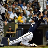 Aug 4, 2015; Milwaukee, WI, USA; Milwaukee Brewers right fielder Ryan Braun (8) scores as San Diego Padres catcher Derek Norris (3) waits for the ball in the seventh inning at Miller Park. Mandatory Credit: Benny Sieu-USA TODAY Sports