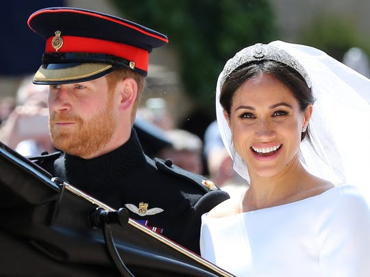 Britain's Prince Harry, Duke of Sussex and his wife Meghan, Duchess of Sussex begin their carriage procession in the Ascot Landau Carriage after their wedding ceremony at St George's Chapel, Windsor Castle, in Windsor, on May 19, 2018.