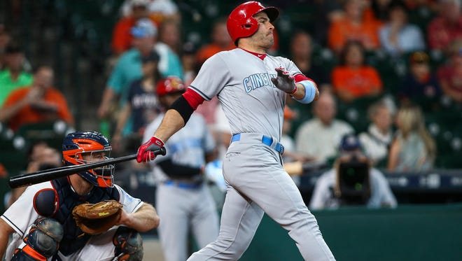 Cincinnati Reds first baseman Joey Votto (19) hits a single during the first inning against the Houston Astros at Minute Maid Park.