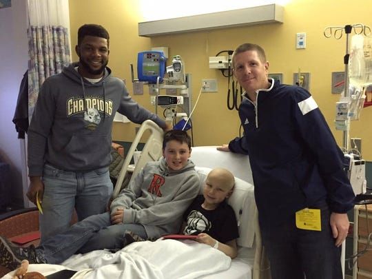 From left: Michael Esiobu, Jon Deppiesse, Mason Deppiesse and Lakeland head football coach Colin Bruton visit Mason in the hospital around Christmas 2015. Esiobu and the Deppiesse brothers have since struck up a close bond.