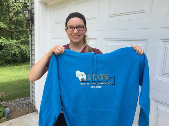 Jordan Becker holds up a sweatshirt with the Wisconsin State Water Ski Show Championships logo she designed in 2016.
