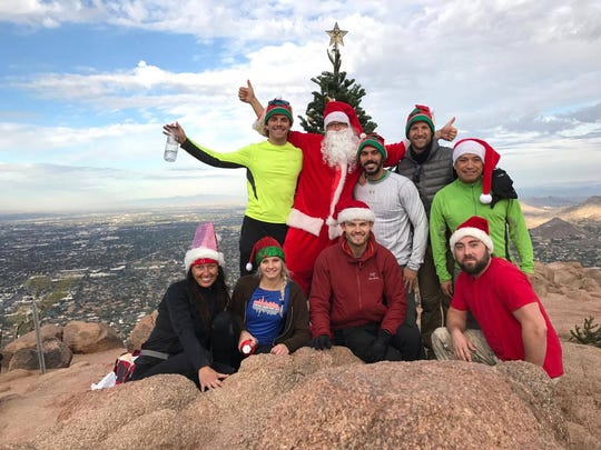 A group carried a new Christmas tree to the top of