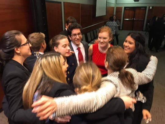 Ray High School mock trial students and their teacher, Mara Schechter Butler, embrace after winning the Region 2 contest Saturday, Feb. 4, 2017.