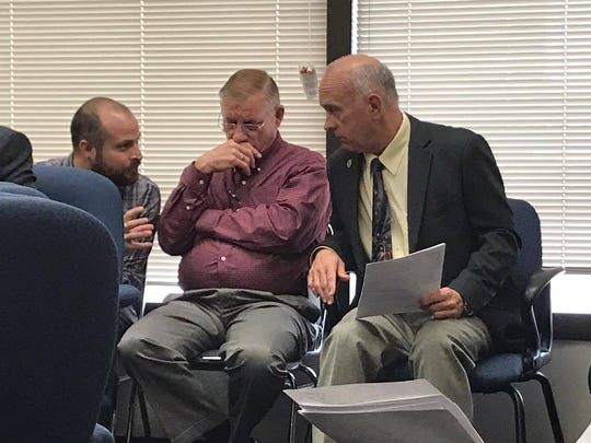 Commissioner Mike Pusley listens to Information Technology Department officials during a judges' meeting Jan. 18 about reporting issues with a new system.