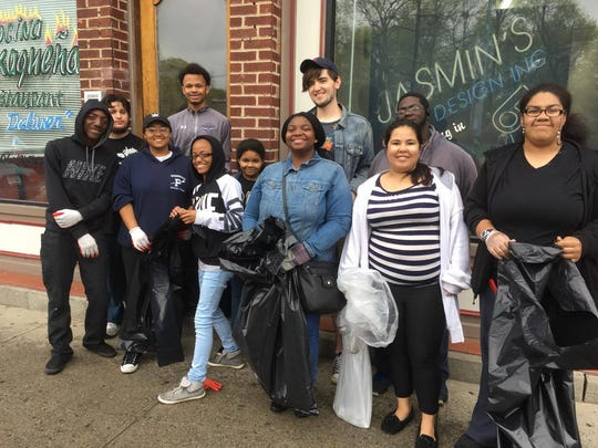 Poughkeepsie High School's Career Action Center -- current students and graduates -- clean up Main Street near the Poughkeepsie Underwear Factory.
