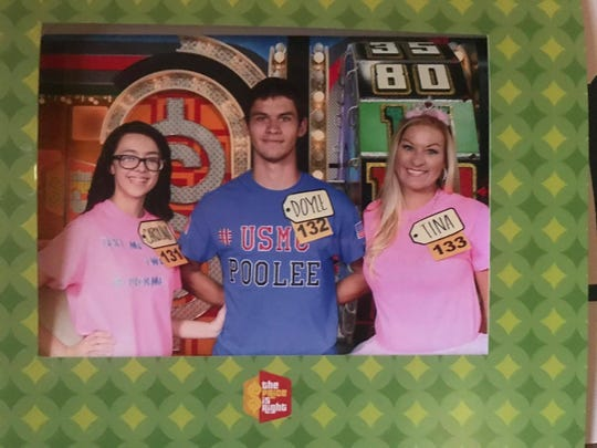 "Aimee Wofford (right) was chosen to play ""The Price is Right"" during spring break 2017. She had taken a multi-state road trip with her son Doyle Wofford (center) and his girlfriend, Cat Trent, before his high school graduation."