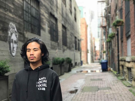 Rommel G. Manjares, graduating from Olympic High School, was photographed by his friend Jairen Enguillado in an alley in Seattle's Chinatown for his senior portrait.