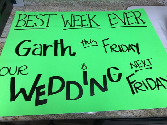 "Jamie Guillot's sign for Garth Brooks' opening night concert in Lafayette June 23 reads ""Best week ever: Garth this Friday, our wedding next Friday."" Brooks sang to Guillot and her fiance from the stage in the Cajundome."