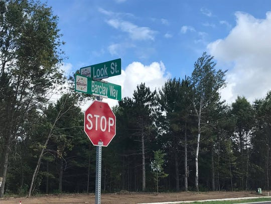 Street signs have been erected in honor of those who