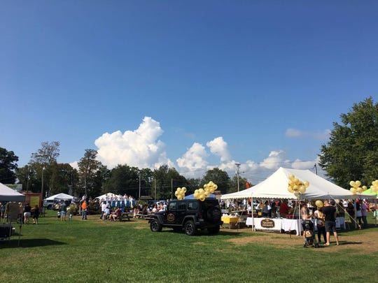 Crowds fill the Ulster County Fairgrounds Sunday. It