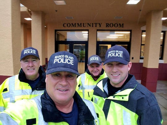 The group of Marco Island Police Department officers who stayed at the police station during Hurricane Irma pose for a selfie. Hurricane Irma made landfall on Marco Island on Sunday, Sept. 10, 2017.