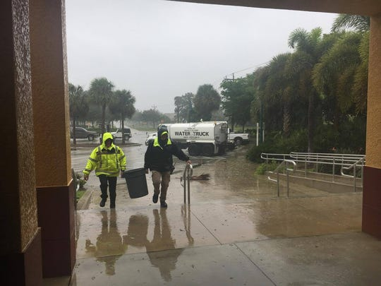 Two Marco Island Police Department officers haul water from a tank to the police station where they were staying during Hurricane Irma. Hurricane Irma made landfall on Marco Island on Sunday, Sept. 10, 2017.