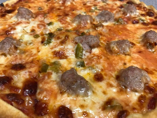 Sam's Special pizza combines house-seasoned sausage, green peppers and onions at Sam's Pizza.