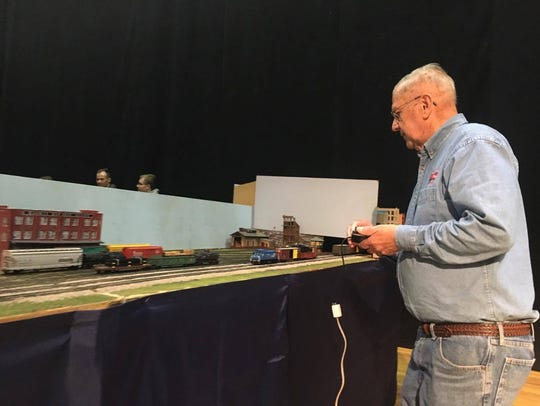 Ed Miller, 80, plays with his club's model train set.