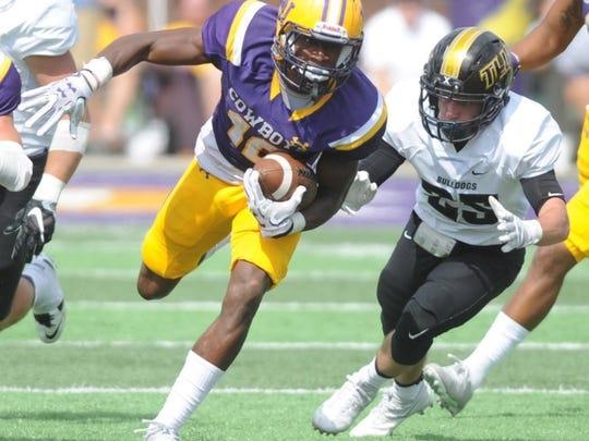 Joey D. Richards/Reporter-News Hardin-Simmons' running back Jaquan Hemphill (16) carries the ball as Texas Lutheran's Justin Thomas (25) gives chase. HSU won the game 48-38 Saturday, Sept. 24, 2016 at Shelton Stadium.