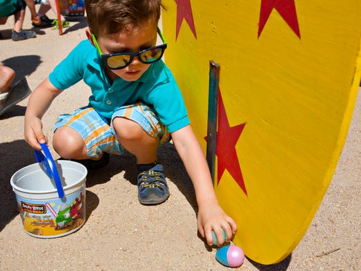 Guests pick easter eggs at Rawhide Pass to celebrate Easter on April 20, 2014.