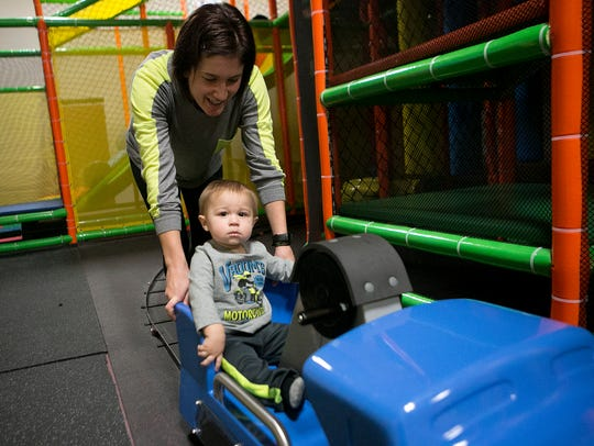 Andrea Hojnacki of Wisconsin Rapids pushes her one-year-old