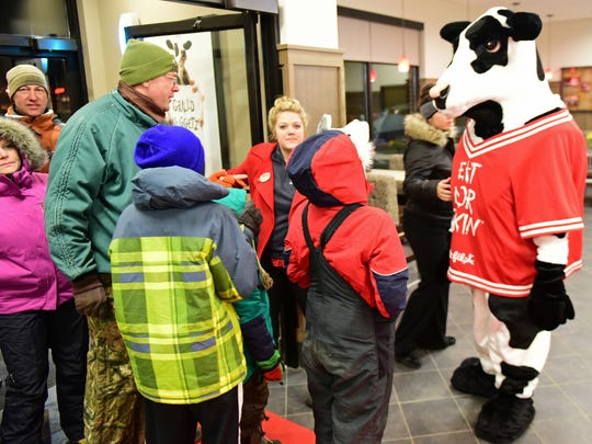 The Chick-fil-A mascot greets customers early Thursday morning, Jan. 28, 2016. The new restaurant is open for business at Norland Avenue, Chambersburg.
