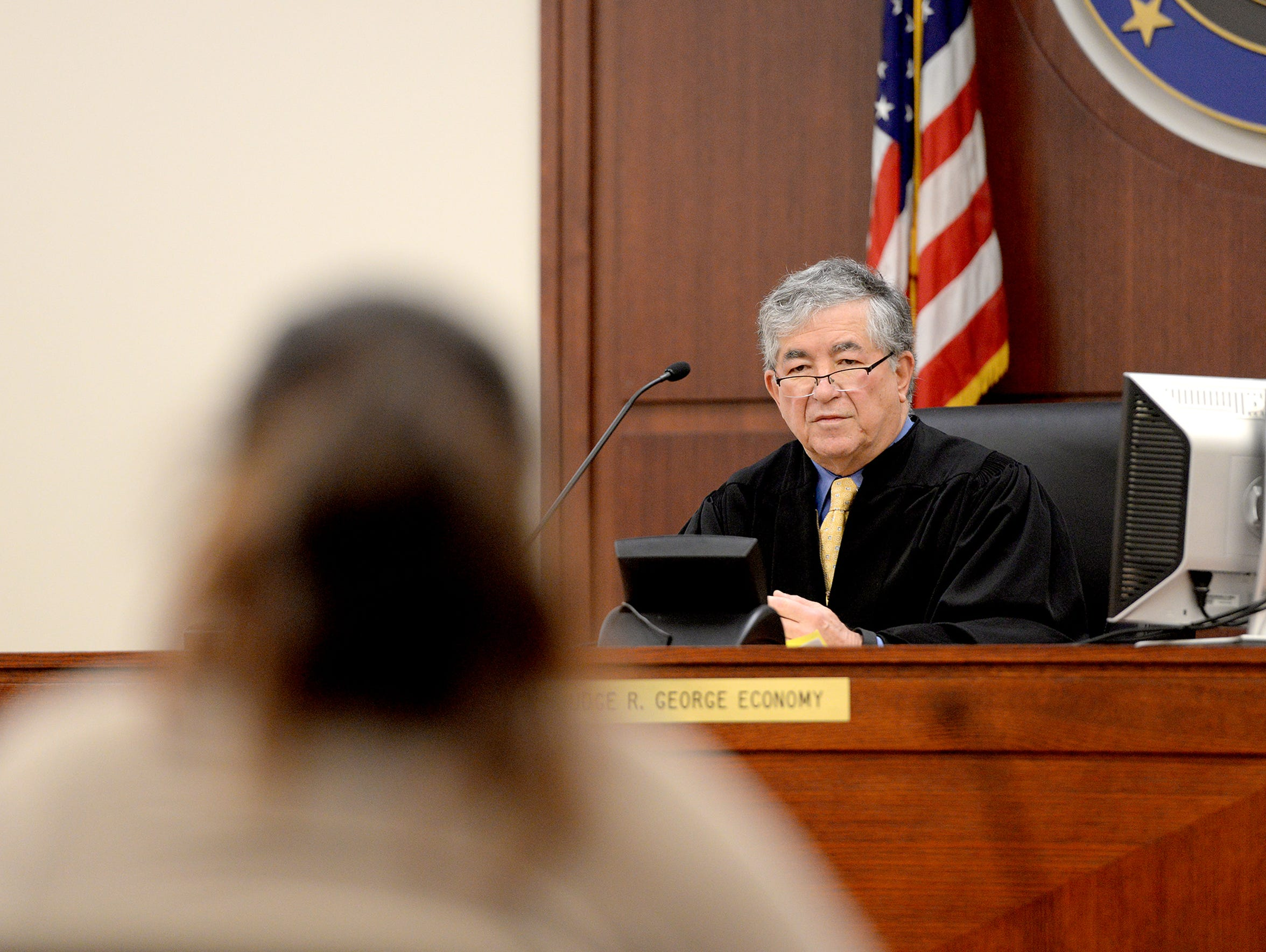 Ingham County Judge George Economy speaks to a defendant