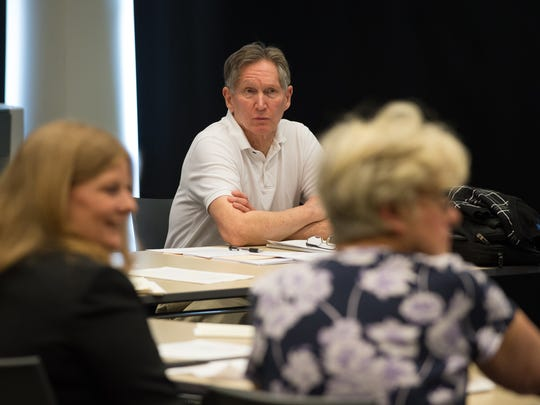 Nick Wasileski, president of the Delaware Coalition for Open Government, listens during their meeting at Woodlawn Library in Wilmington.