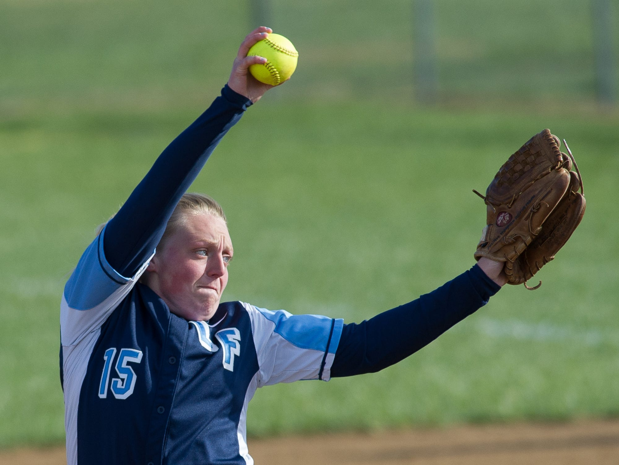 Lake Forest's pitcher Kerrigan Simpson (15) sends a pitch in their game against Red Lion.