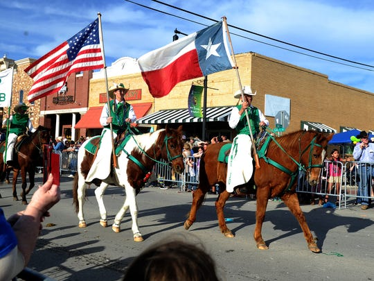 The Saint Jo Riding Club brings up the end of the Nocona Mardi Gras parade Saturday, Feb. 18, 2017, in Nocona along Clay Street.