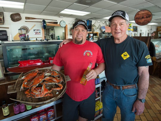 Robert Meding and his father Henry Meding with Meding's Seafood in Frederica.