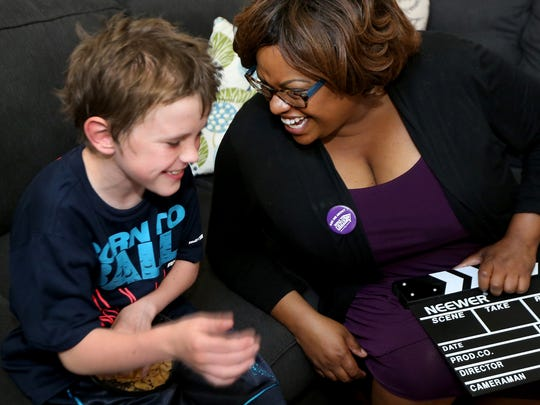 Michelle Thomas, right shares a laugh with her foster son, Chris.