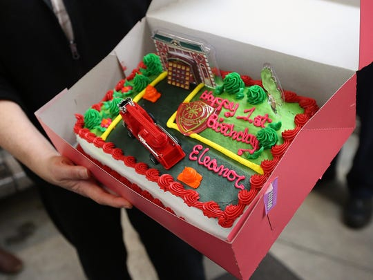 The Rogers family brought a cake adorned with a fire station and a fire truck to celebrate Eleanor's birthday at North Kitsap Fire & Rescue Headquarters Station 81 in Kingston.
