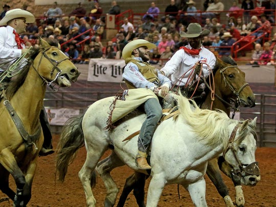 Cody Kiser competes in bareback riding during the second