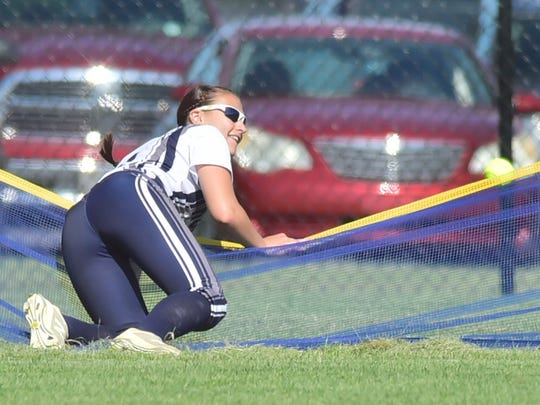 Chambersburg's Taylor Myers chases a homerun by Cumberland Valley's Katie Wingert over the fence. Chambersburg defeated Cumberland Valley 11-5 in a PIAA District 3 softball playoff game on Tuesday, May 23, 2018 at Norlo Park.