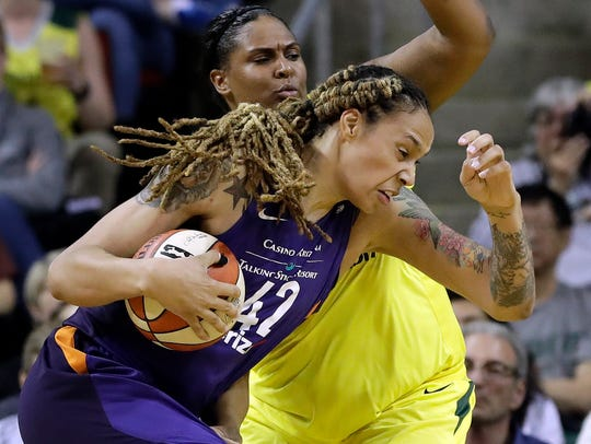 Brittney Griner of the Phoenix Mercury drives past