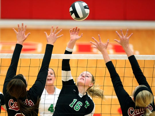 Yorktown's Kelsey Barker eases the ball over the net
