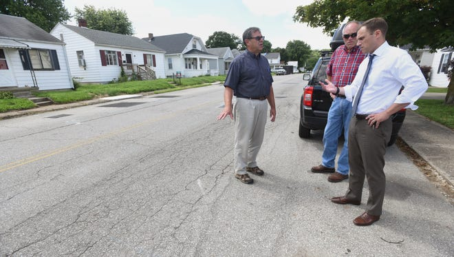 Tom Day, left, and Jim Tribby talk to Chillicothe Mayor Luke Feeney about road issues on Orange Street near Piatt Avenue Aug. 22.