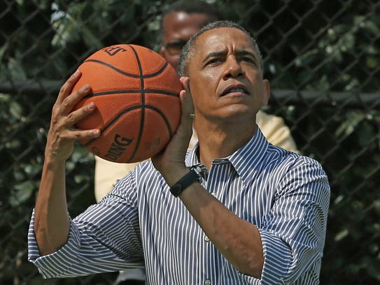 President Obama plays basketball during the annual