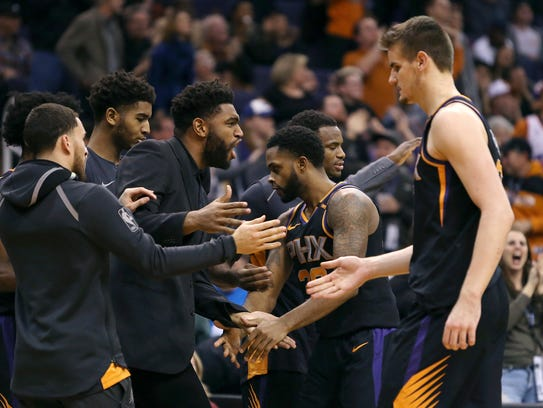 Troy Daniels (30) and Dragan Bender (right) are congratulated