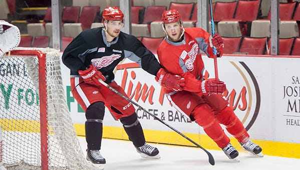 Brendan Smith, left, Justin Abdelkader skate during the Wings' practice Monday at Joe Louis Arena.